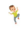 cute happy little boy dancing in casual clothes vector image vector image