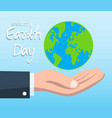 earth day concept with hand holding blue globe vector image vector image