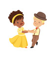 cute smiling little boy and girl dancing in vector image