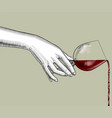 female hand pours wine from a glass vector image vector image