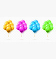 flying bunch gold pink blue and green balloon vector image vector image