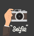 businessman hands holding camera selfie vector image vector image