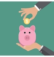 Piggy bank and hand put coin vector image