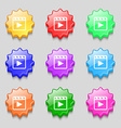 Play video icon sign symbol on nine wavy colourful vector image vector image