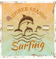 surfing colored vintage emblem with dolphins vector image