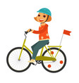 little redhead girl in helmet rides bicycle with vector image