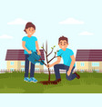 two smiling volunteers planting tree little vector image vector image