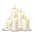 White wax cylindrical candles with a burning wick vector image