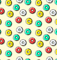 Seamless pattern of bright multi-colored donuts vector image vector image