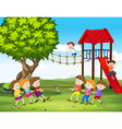 Children playing tug of war in the playground vector image