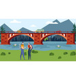 tourists with backpacks stand on river bank vector image vector image
