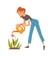 beautiful young woman watering flowers in the vector image