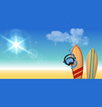 two surfboards with diving mask on the beach vector image