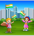 happy kids holding national flag on the city park vector image