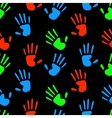 Colorful fluorescent human hands prints on black vector image