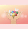 easter eggs in two hand withe butterfly vector image