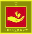 hands holding baby foot vector image vector image