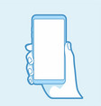 hand holding smart phone on blue background vector image vector image
