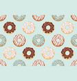 seamless pattern with glazed donuts blue and vector image vector image