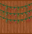 glowing multicolored christmas lights three lines vector image