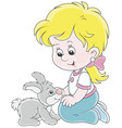 little girl and her small rabbit vector image