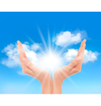 Hands with a bright sun vector image