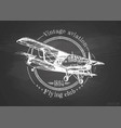 Vintage biplane on blackboard vector image