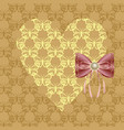 yellow heart with a pink bow vector image vector image