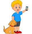 cartoon little boy holding a mobile phone with his vector image vector image