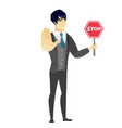 asian groom holding stop road sign vector image vector image