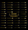 hand-drawn gold doodle arrows set isolated on vector image