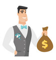 young caucasian groom showing a money bag vector image vector image