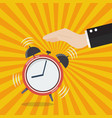 hand turns off the alarm clock vector image