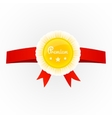 Metal premium round badge on red ribbon isolated
