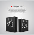 black shopping bags with written sale vector image vector image