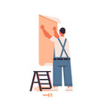 professional worker in uniform glues wallpaper to vector image