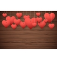Wooden background with red hearts vector image vector image