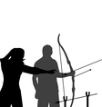 Instructor teaching a man how to shoot bow vector image vector image