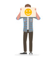 man holding an happy emoji sign in front his vector image