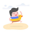 young man on beach with rubber duck swim ring vector image