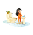 A cute little girl washing her hands vector image