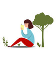 girl reading under tree vector image