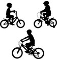 kids riding bicycles silhouettes vector image vector image