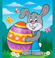 bunny holding big easter egg theme 2 vector image