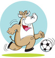 Cartoon cow playing soccer vector image vector image