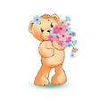 little toy bear with big bouquet of wild flowers vector image