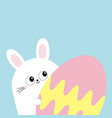 white bunny rabbit holding big painted egg happy vector image