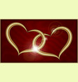 two golden hearts on red velvet vector image