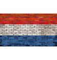 Grunge flag of Netherlands on a brick wall vector image vector image