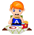 a young boy eating in a restaurant vector image